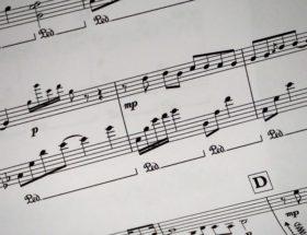 a close up of a sheet of music