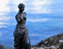 a statue of Venus de Milo near the ocean